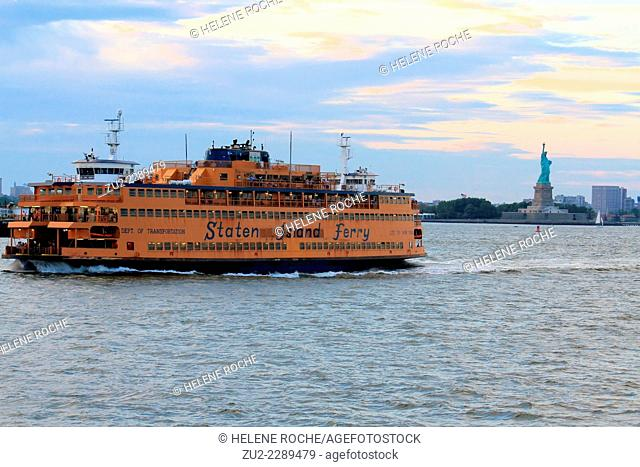 Staten Island Ferry with the statue of liberty in the background, New York City, USA
