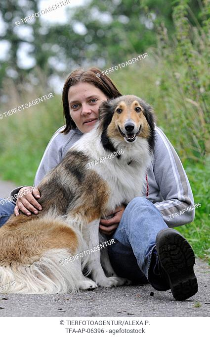 woman and longhaired collie