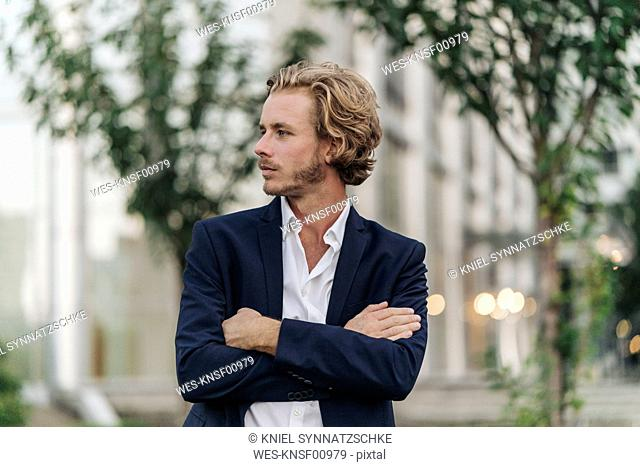 Businessman outdoors looking away