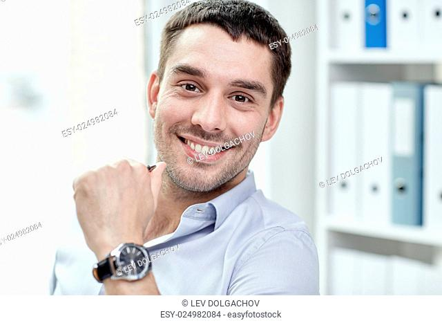 business, people and work concept - portrait of smiling businessman face in office