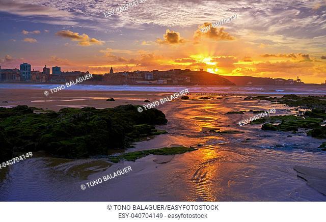 Gijon skyline sunset in San Lorenzo beach of Asturias in Spain