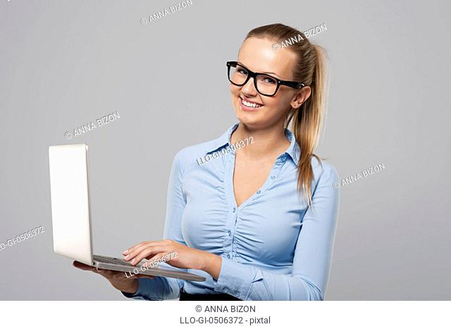 Beautiful young businesswoman using laptop, Debica, Poland