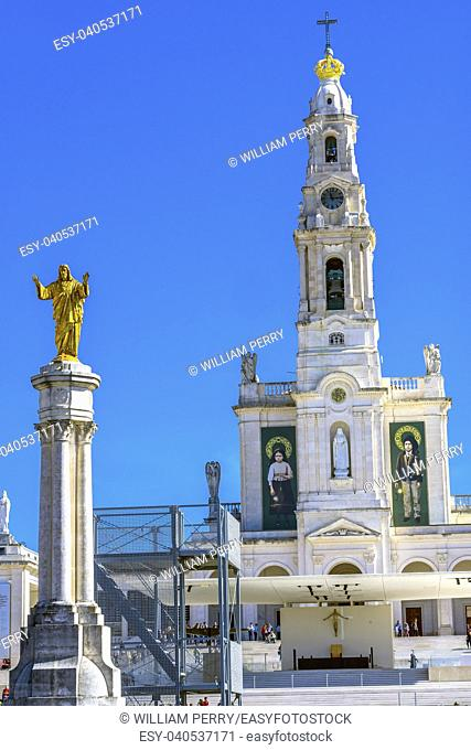 Christ Statue 100th Cellebration Mary's Appearance Basilica of Lady of Rosary Bell Tower Fatima Portugal. Church created on site where three Portuguese Shepherd...