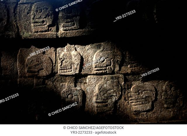 Skulls decorate the tzompantli or Skull Platform in the Mayan city of Chichen Itza, Yucatan Peninsula, Mexico