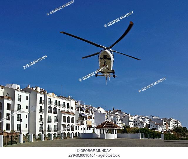 Helicopter taking of after a medical emergency, Frigiliana, Near Nerja, Malaga, Spain
