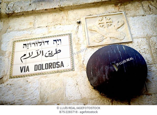 Ceramic plate in the wall of the Via Dolorosa. Via Crucis, the fifth stop, in Jerusalem, Israel