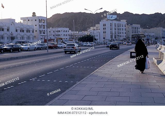 Mutrah District, street, Muslim woman walking, Muscat, Oman, Middle East