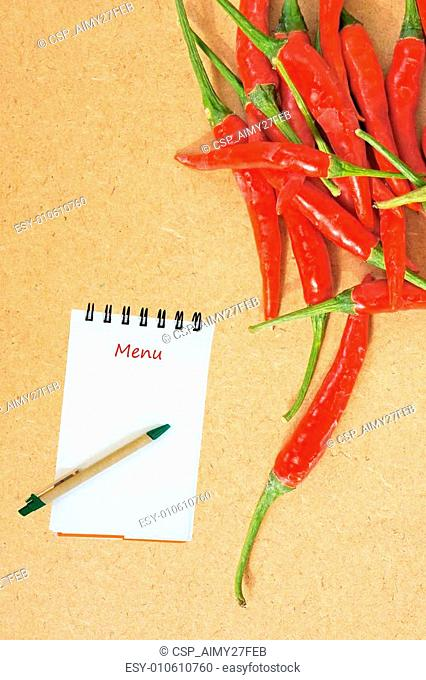 Red chili on a Wooden Background and paper for notes