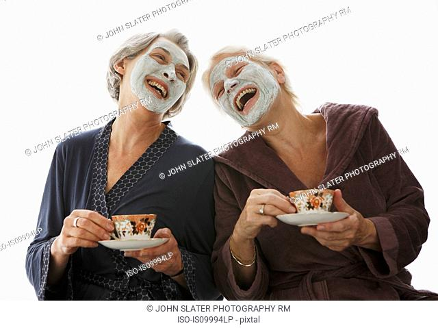 Senior women in beauty masks, laughing