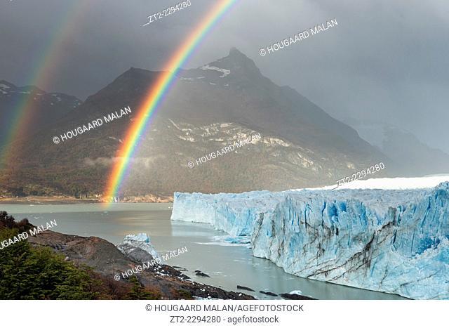 Landscape photo of a double rainbow over the glacier. Perito Moreno Glacier, Patagonia, Argentina
