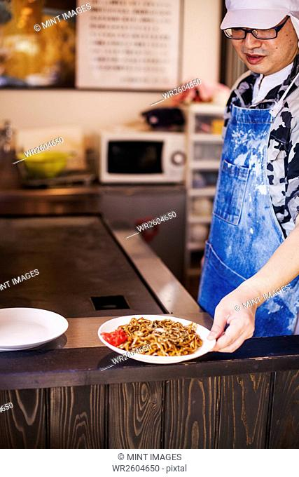 Man cooking Soba noodles