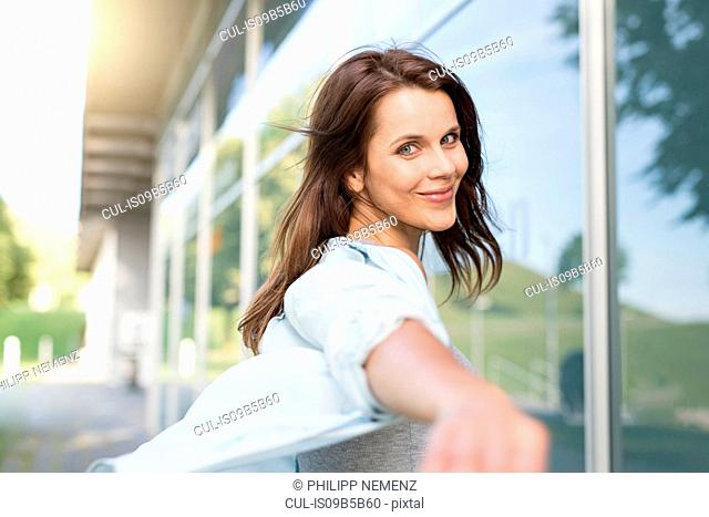 Portrait of happy businesswoman outside airport