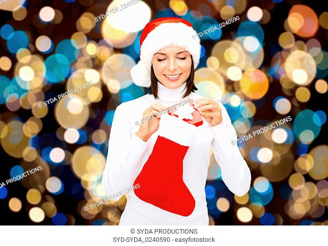 woman in santa hat with christmas gift and sock