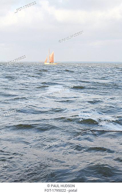 Sailboat on choppy ocean