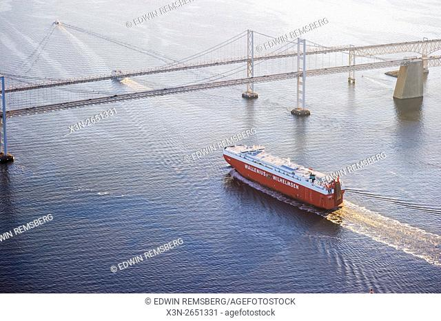 Aerial view of a boat going under the Chesapeake Bay Bridge in Maryland