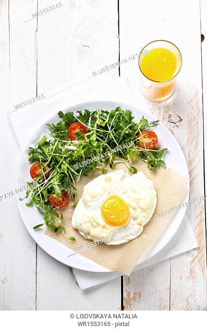 Breakfast baked egg with salad