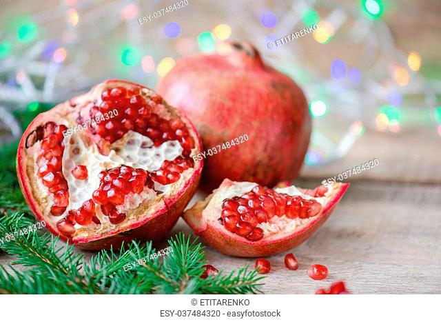Pomegranate with festive decorations
