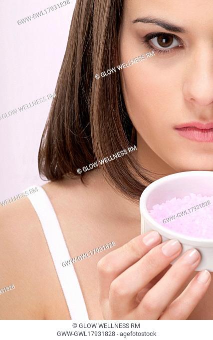 Portrait of a woman smelling bath salt