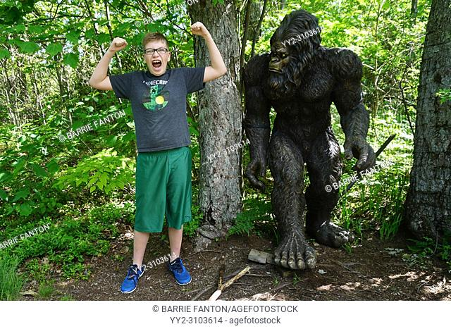Preteen Boy Posing With Bigfoot Statue, Rock City Park, Olean, New York, USA