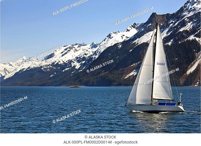 Small sailboat on pleasure cruise at Orca Inlet near Cordova Alaska Prince William Sound SouthCentral Summer