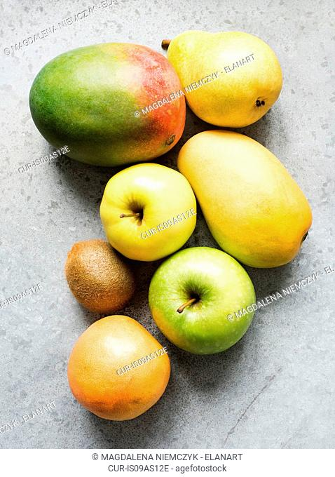 Ripe fruit with apple, mango, kiwi, quince and pear