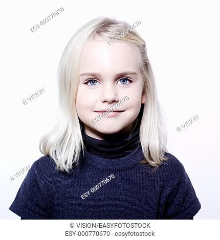 studio portrait of a caucasian cute litle girl