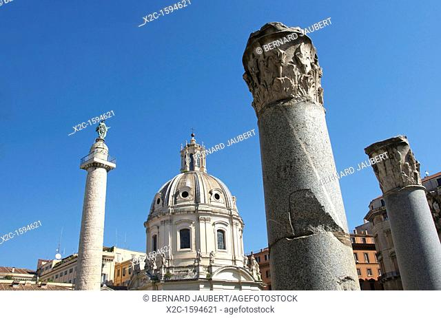 Trajan's column and dome of Santissimo Nome di Maria al Foro Traiano or Church of the Most Holy Name of Mary at the Trajan Forum, Rome, Italy, Europe