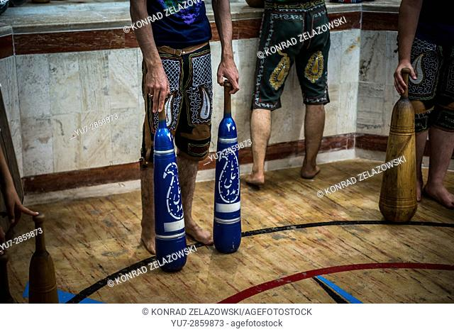 Iranian men and boys training with wooden clubs in Zoorkhaneh (House of Strength), traditional gymnasium in Yazd city, Yazd Province of Iran