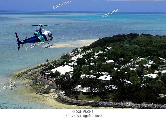Helicopter shuttle approaching resort, Heron Island, Great barrier Reef, Australia