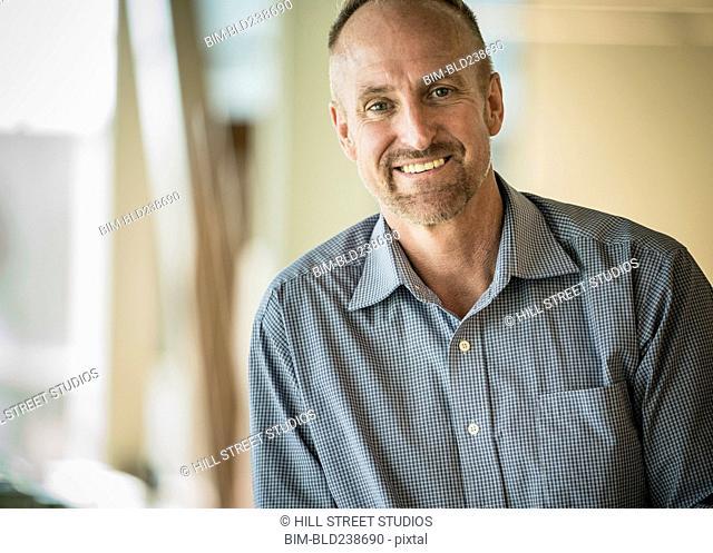 Portrait of smiling Caucasian businessman