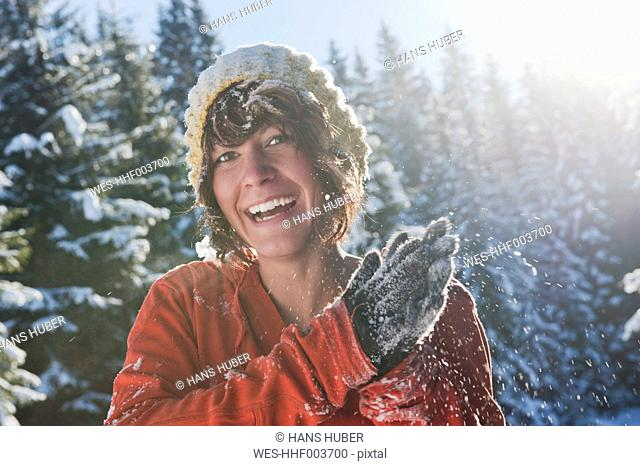 Austria, Salzburg Country, Flachau, Young woman having fun in snow