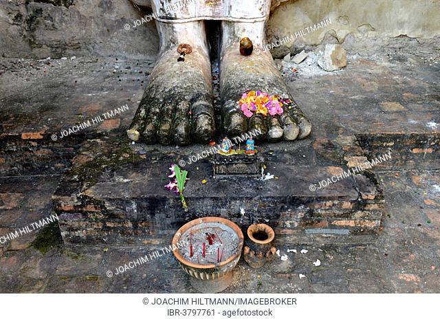 Feet of the standing Buddha statue Phra Attharot, Wat Mahathat temple complex, Sukhothai Historical Park, Sukhothai, Northern Thailand, Thailand