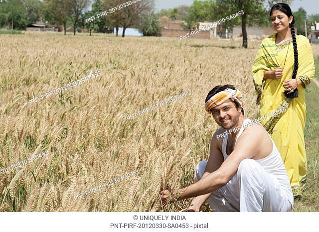 Rural couple in the field, Sohna, Haryana, India