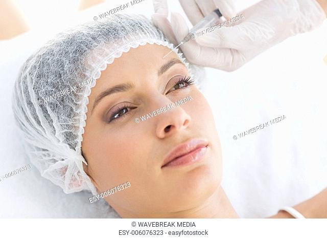 Beautiful woman receiving botox injection