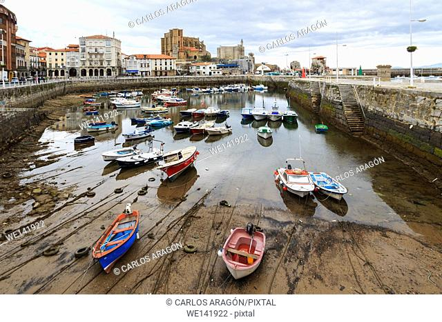 Port of Castro Urdiales, with the church of Santa Maria de la Asuncion and Castle Lighthouse in the background. Cantabria, Spain