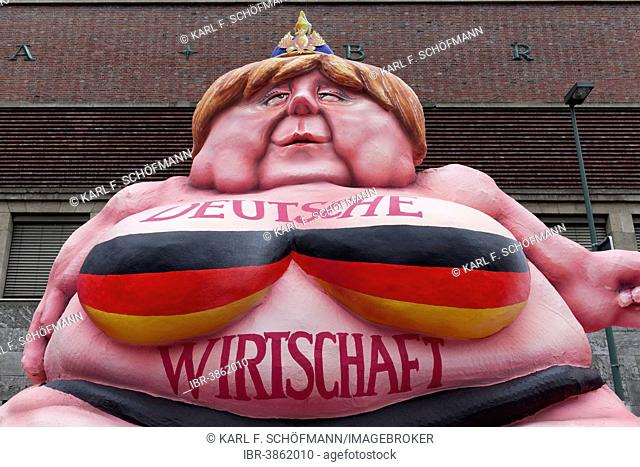 German Chancellor Merkel as a fat Buddha, political caricature about the German economy, papier-mâché figure for the Rose Monday parade, Carnival, Düsseldorf