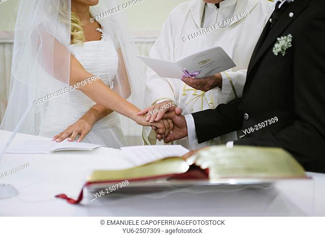 Priestly blessing of the hands of the newlyweds