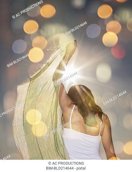 Caucasian woman waving scarf