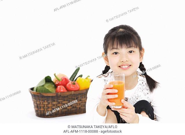 Japanese holding glass of orange juice