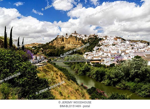 Village on hillside near bridge and river, Arcos de la Frontera, Andalusia, Spain