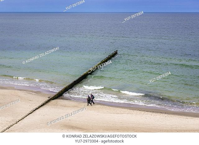 Wooden breakwater seen from cliffs between Trzesacz and Rewal villages in West Pomeranian Voivodeship of Poland