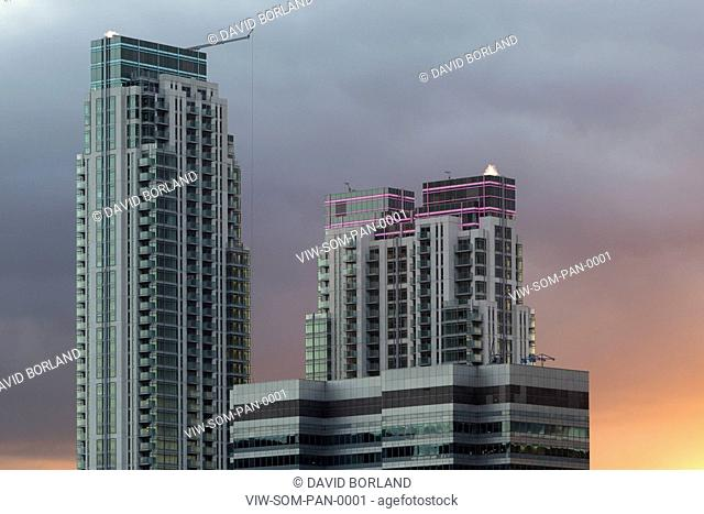Pan Peninsula, twin towers against stormy evening sky