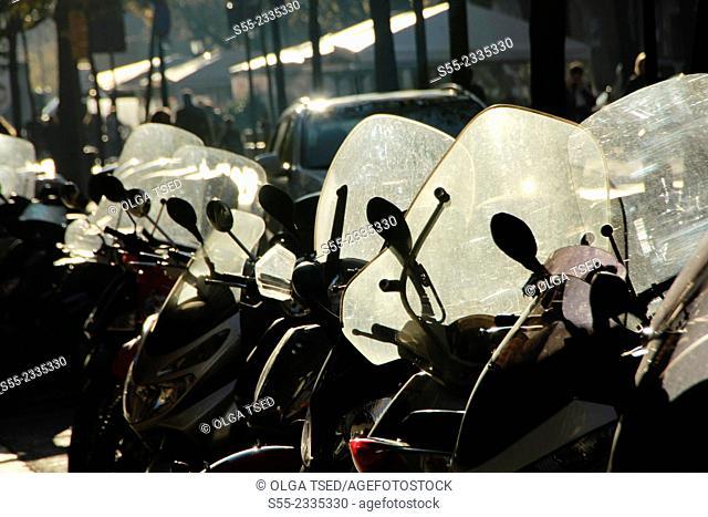 Motorbikes parked at Rambla Catalunya. Barcelona, Catalonia, Spain