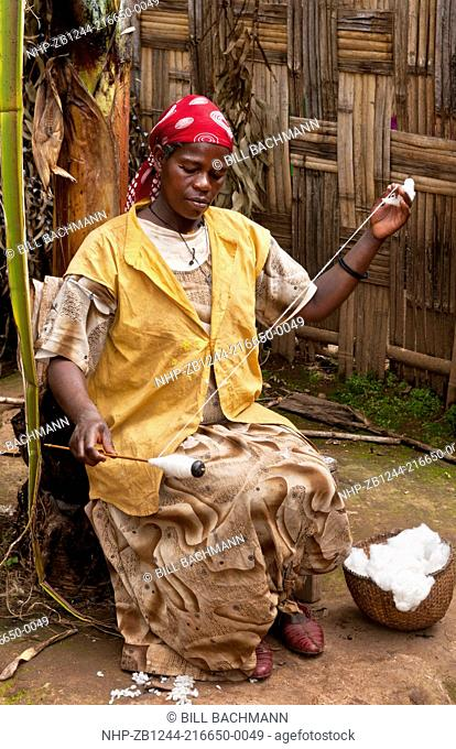 Arba Minch Chencha Ethiopia Africa Dorze tribe village local woman spin cotton with traditional methods and spinning wheel 12