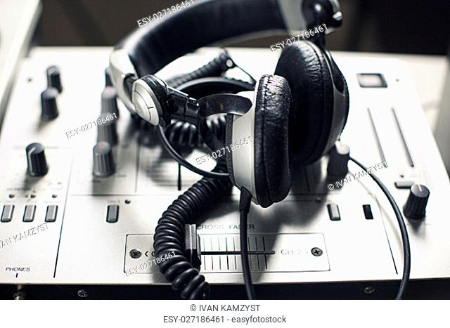 DJ mixer and headphones with a vinyl record, close up