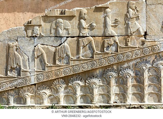 Persepolis, Iran - 24 February 2016: Frieze with rocession of gift bearers on Tashara staircase