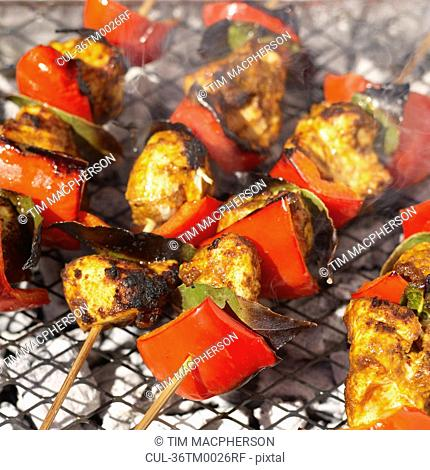Chicken tikka kebabs on grill
