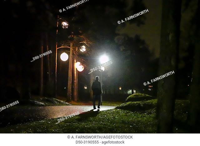 Stockholm, Sweden A lone male walks along a wooded path in the Handen suburb south of town