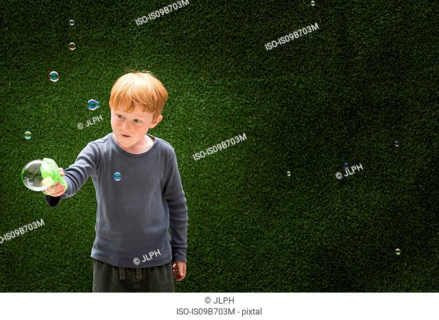 Boy making bubble maker