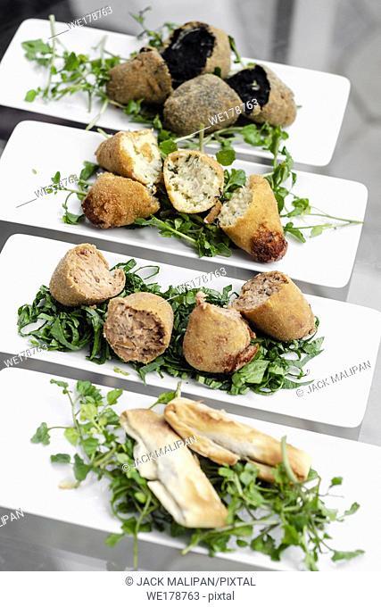 selection of traditional portuguese tapas snacks on lisbon restaurant table